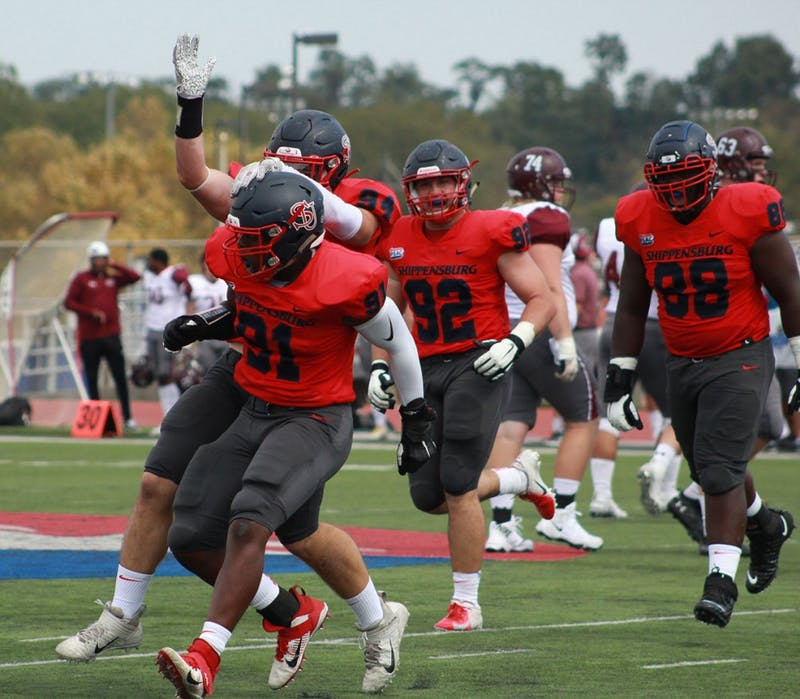 The Red Raider defensive line celebrates with Aaron Alphee (No. 91) after one of his two sacks in Saturday afternoon's 30-15 victory over Bloomsburg. The SU front seven haunted the Huskies' offensive line all day, racking up a season-high six sacks in the win.