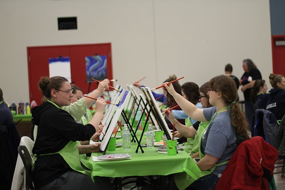 Students paint Northern Lights at Paint Nite