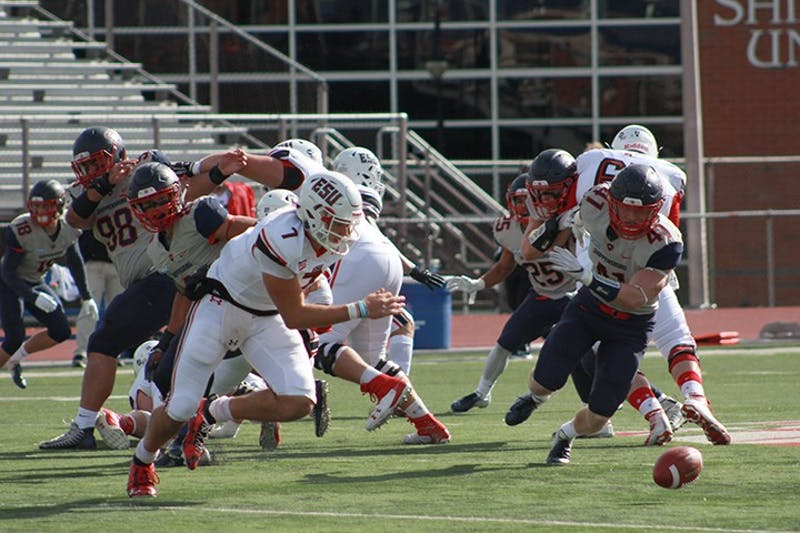The Red Raider defense scrambles to recover one of their two forced fumbles in the game against ESU.