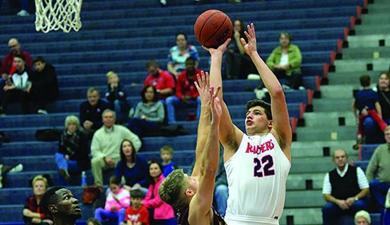 SU's John Castello puts up a shot against Gannon University in Saturday's win.