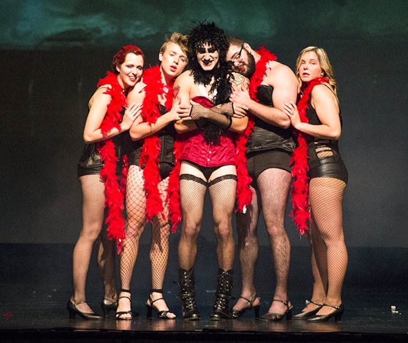 "Several members of the 2017 cast of ""The Rocky Horror Picture Show"" finish acting out a scene from the well-known movie. Every year, a cast mimes along to the Rocky Horror movie around Halloween for a fun show."