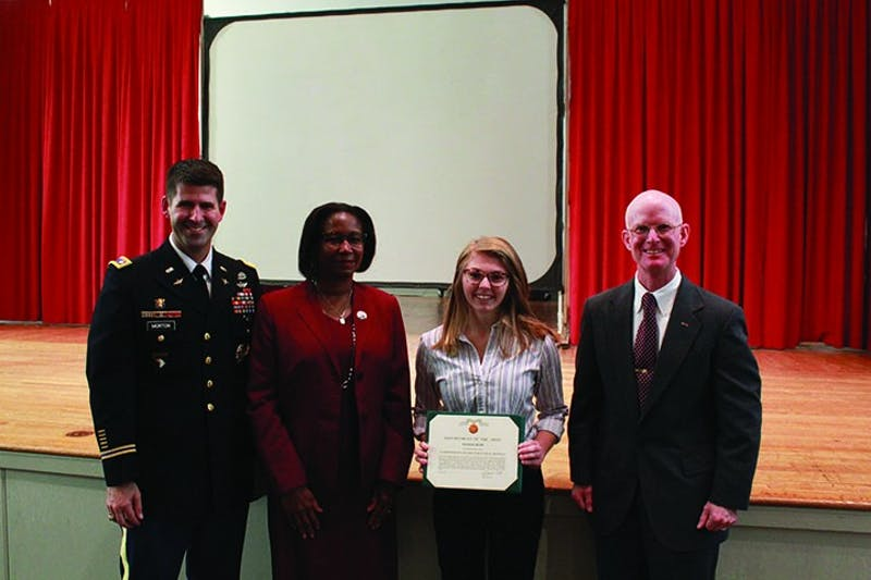 Senior Rachael Rudis was awarded the Commander's Award for Public Service during the Veteran's Day ceremony. Pictured from left to right are Lt. Col Christopher Morton, SU President Laurie Carter, Rudis and SU political science Professor James Greenburg.