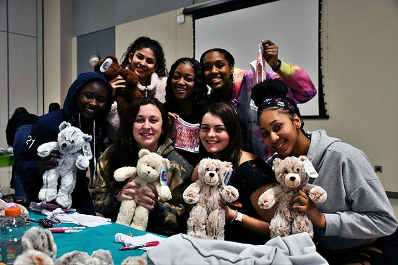 Students pose with their teddy bears during the event. APB plans to host similar events in the future because of the high turnout.