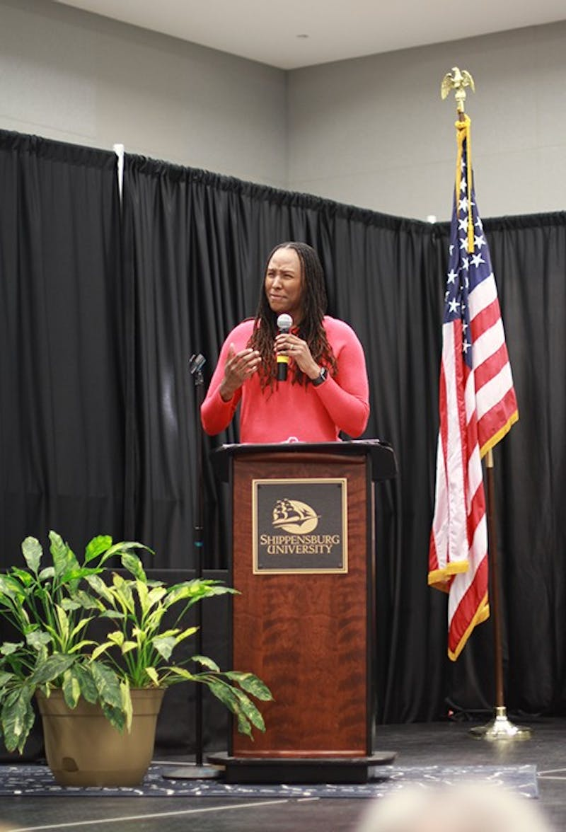 Chimique Holdsclaw shares her personal struggles with SU students as part of the SU Women's Center's celebration of Women's History Month. Holdsclaw encouraged the audience to reach out and tell someone if they are struggling.