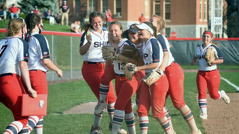 The softball team celebrates after picking up the sweep over Kutztown University.