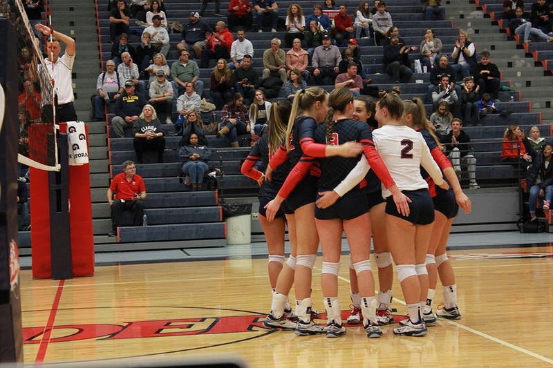 The Raiders rally together after a point in their 3-0 PSAC quarterfinal victory over Clarion University Tuesday night at Heiges Field House.