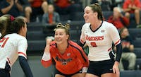 Megan Forstburg and Gabriella Johnson are senior leaders on a Raiders volleyball team that feeds off one another's energy.