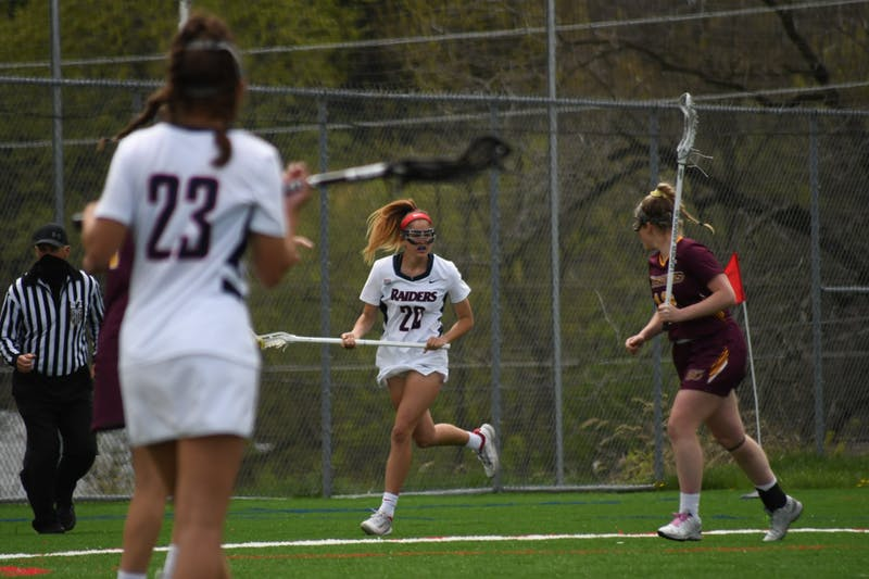 Bailey Krahl cradles the ball in a game earlier this season. She scored 11 goals in her debut year.