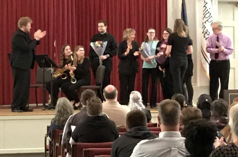 The senior members of the string ensemble, flute choir and saxophone choir are recognized with flowers at the end of their performance on Saturday.