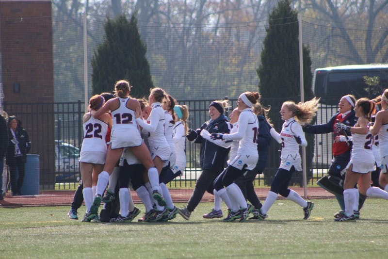 The SU field hockey team swarms the field after defeating East Stroudsburg University, 2-1 to advance to its second straight NCAA title game.