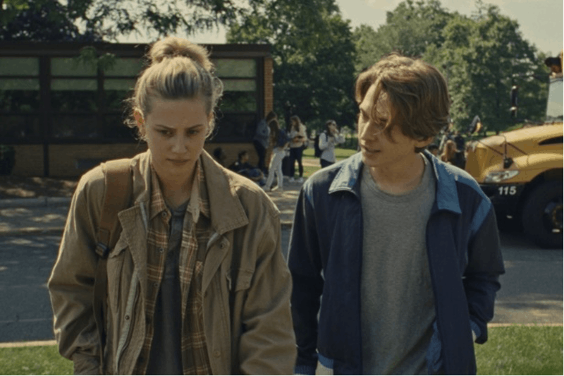 "Abrams and Reinhart walk together to school. ""Chemical Hearts"" is rated with a 62% on Rotten Tomatos and an audience score of 71%. The movie is rated R."