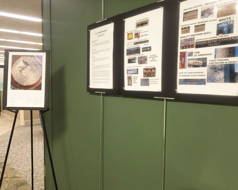 Students showed off their poems at a recent exhibit in the library. This is the second year the event has been held.