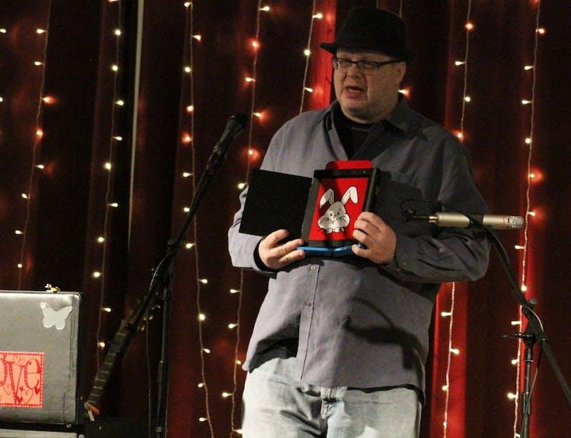 Magician David Mark Hornberger plays tricks on Open Mic members' minds.