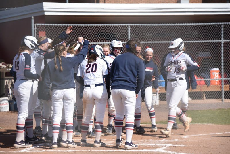 SU's softball team comes together at home plate to celebrate junior Courtney Coy's home run in a game last season.
