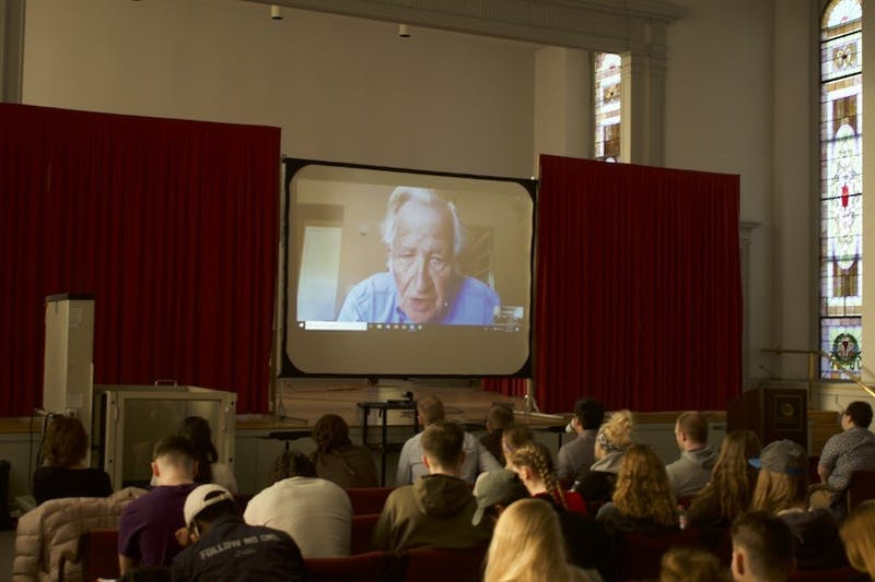Noam Chomsky speaks to the audience of students through Skype about human existence and the possible end to humanity. Chomsky explained the Doomsday Clock which is currently two minutes to midnight which is the closest its been since 1953.
