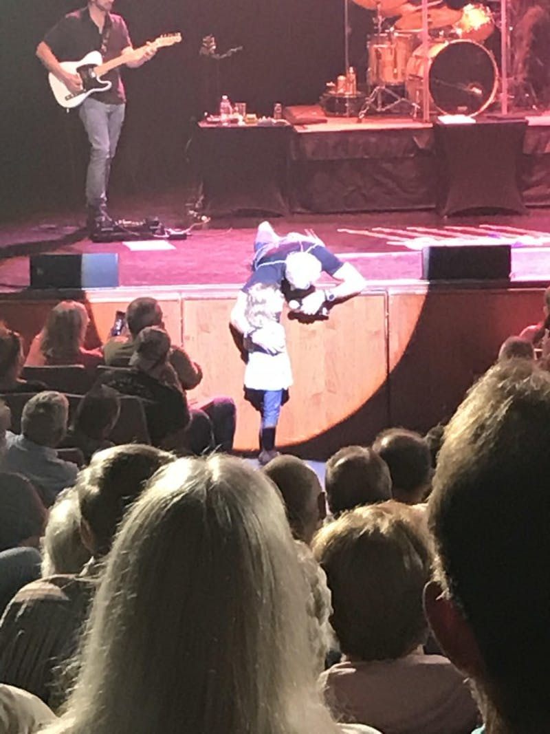 Tippin laid down and reached his microphone out to sing with a young girl in the front row.