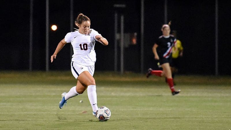 K.K. O'Donnell pushes the ball up the field vs. MU.