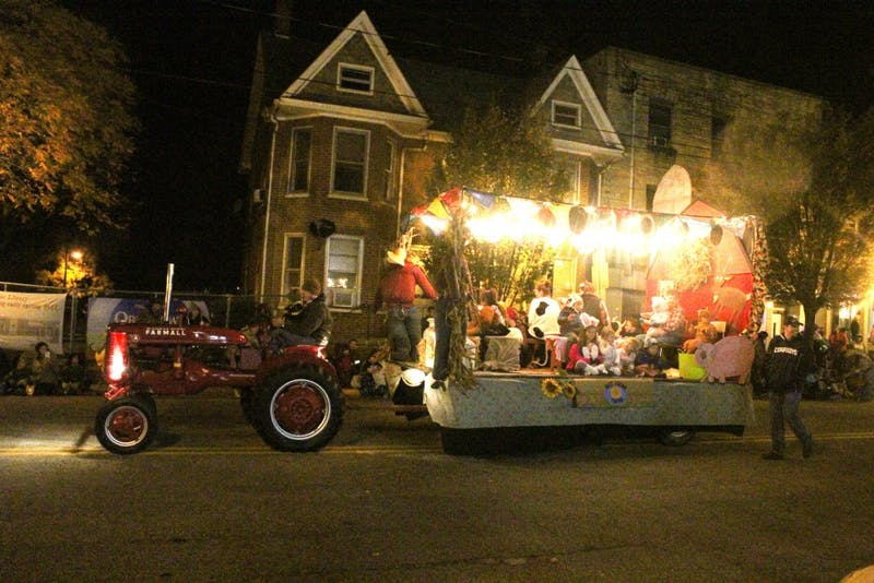 Parade floats drive through downtown Shippensburg during the town's annual Halloween parade. Members of the community gathered along both sides of King Street to watch the display.