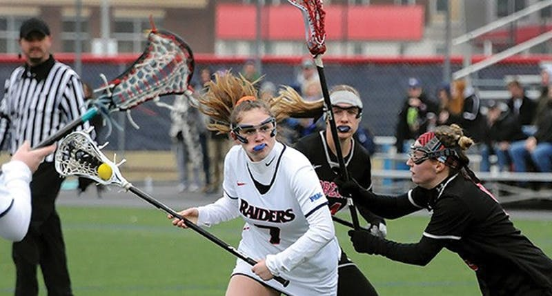 SU's Alana Cardaci, center, scored six goals in the Raiders 17-16 overtime loss on Tuesday. Cardaci's six goals are the most an SU player has scored in six years.