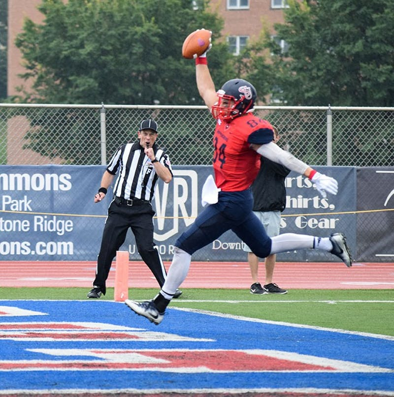 Shippensburg University's Kyle Haines celebrates as he crosses the goal line against American International. The Red Raiders travel to face Gannon University on Saturday.