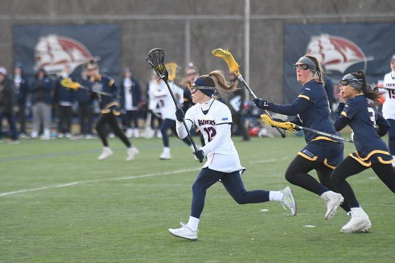 A group of players fight for the ball in front of the NYIT net in the loss on Saturday afternoon. The Raiders totaled 24 shots and six goals against NYIT.