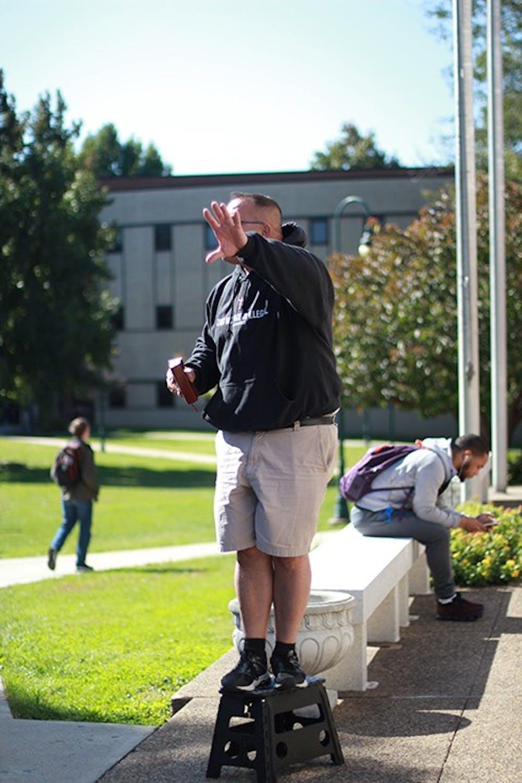 Religious demonstrators cause controversy on SU's campus