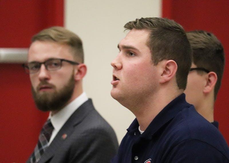 Student Government Association Senator Robert Giulian asks a question during candidates' speeches.