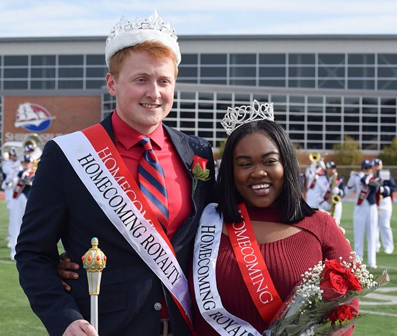 Cody Olson and Karla Moses smile for pictures together after being crowned king and queen. Olson raised more than $2,000, and Moses raised $1,800.