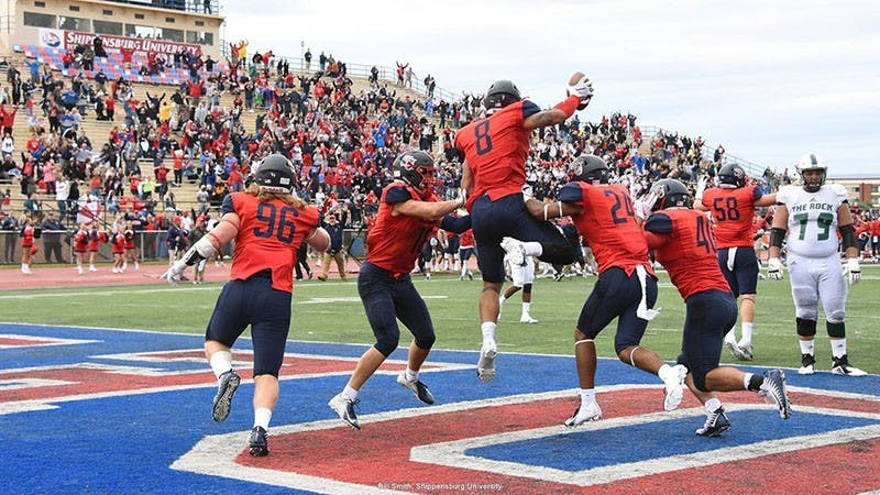 The Red Raiders celebrate after defensive end Richard Nase recovers a bad snap in Slippery Rock's end zone for the go-ahead score in the game's final minute.