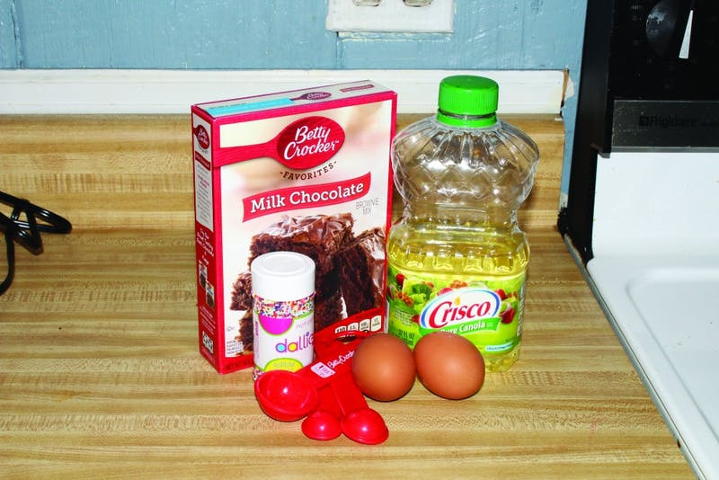 Sofia Perzan tries her hand at recreating the recipe for brownies on the back of the Betty Crocker box, adding her own personal touch of rainbow sprinkles.