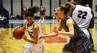 Ariel Jones (left) scores a career-high 38 points in the team's 78-71 loss to Bloomsburg Wednesday night.