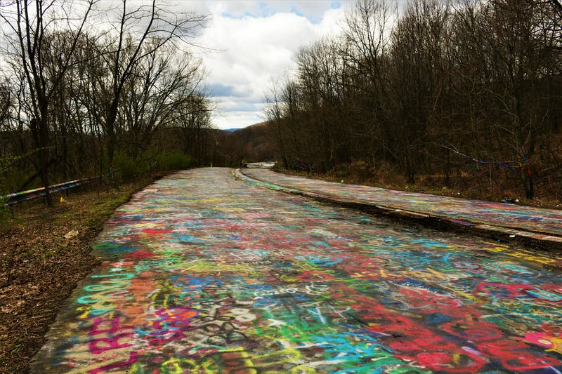 The colorful artwork of Centralia's Graffiti Highway is now buried under tons of dirt.