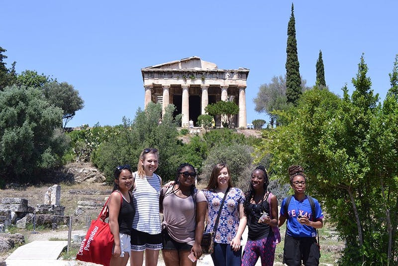 SU junior Aliyah Mensah (second from right) in the Atlantis Project explores the grounds surrounding the Parthenon