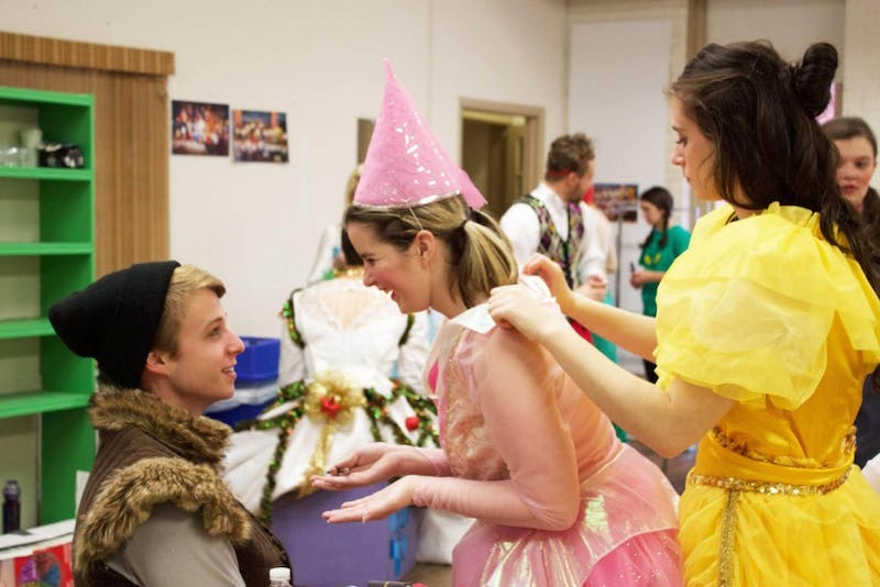 Grant Henry (Kristoff) receives some help applying his makeup from Lexi Haines (Princess Frost) and Nicole Kmiec (Belle).