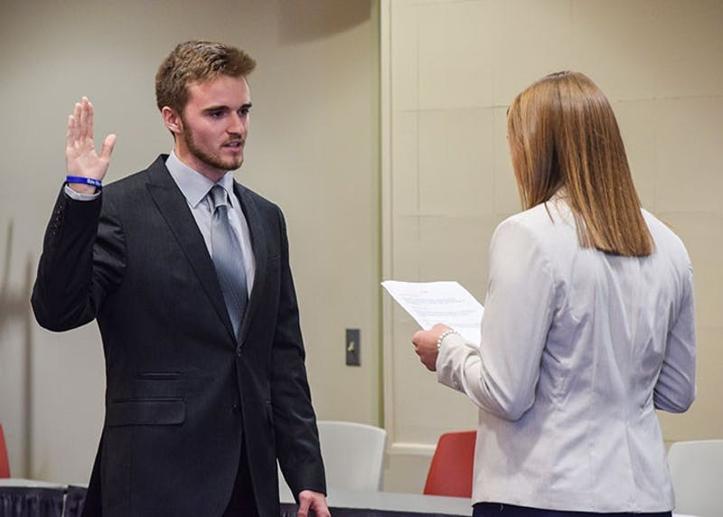 Logan Wein gets sworn in as SGA President by outgoing SGA President Madison Scarr. Wein said leadership is one of the most important things you can do.