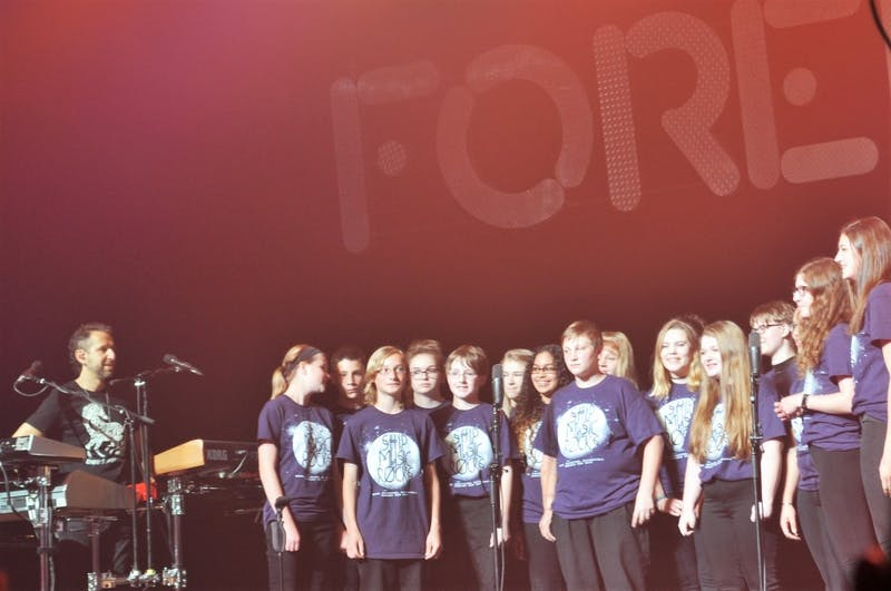 Foreigner highlights the bright future of younger generations and the importance of education by welcoming the Shippensburg Area Middle School chorus on stage to sing alongside the band.