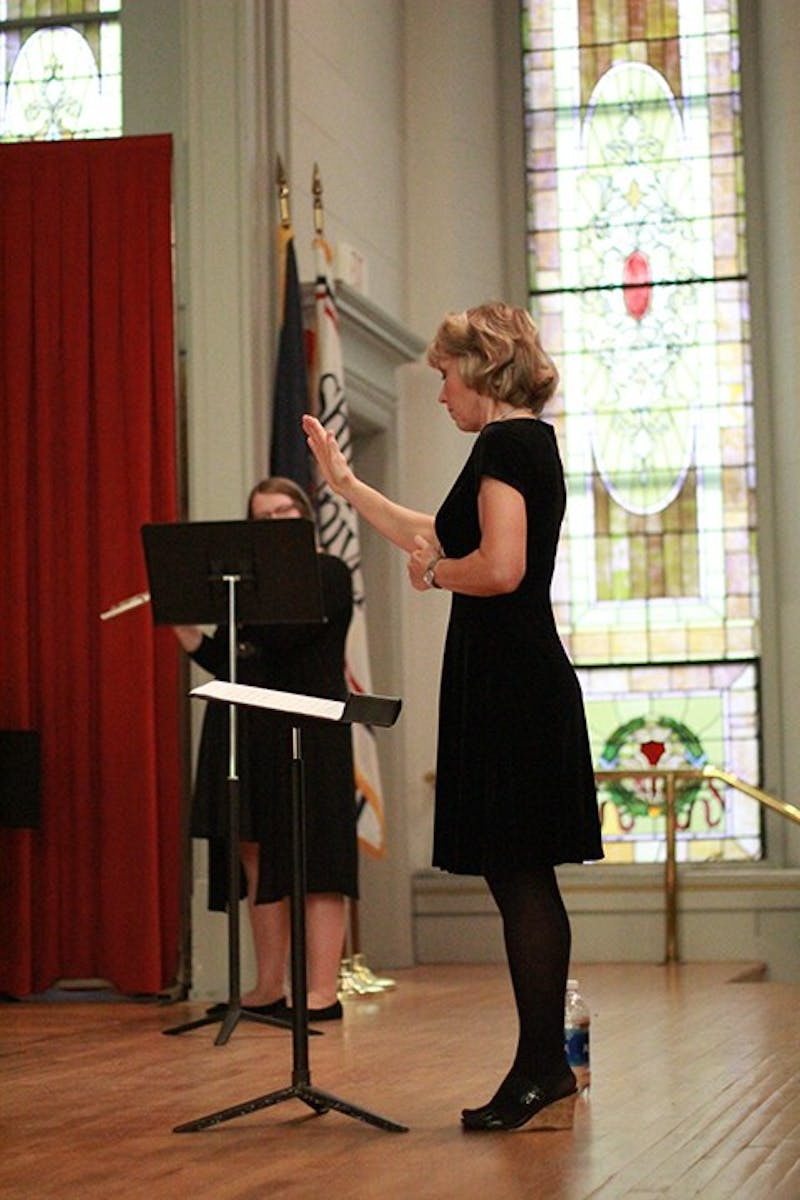 Suzanne Thierry, director of the SU Flute Choir, leads her student musicians through a variety of sounding music from countries around the world including America, Russia, Argentina, England and Germany.