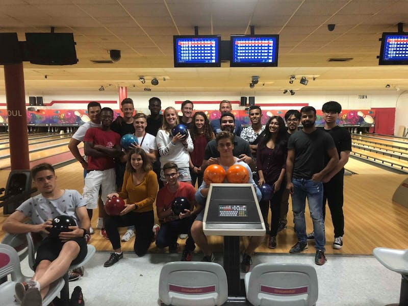 International students enjoy a sense of community among each other during a night out bowling.