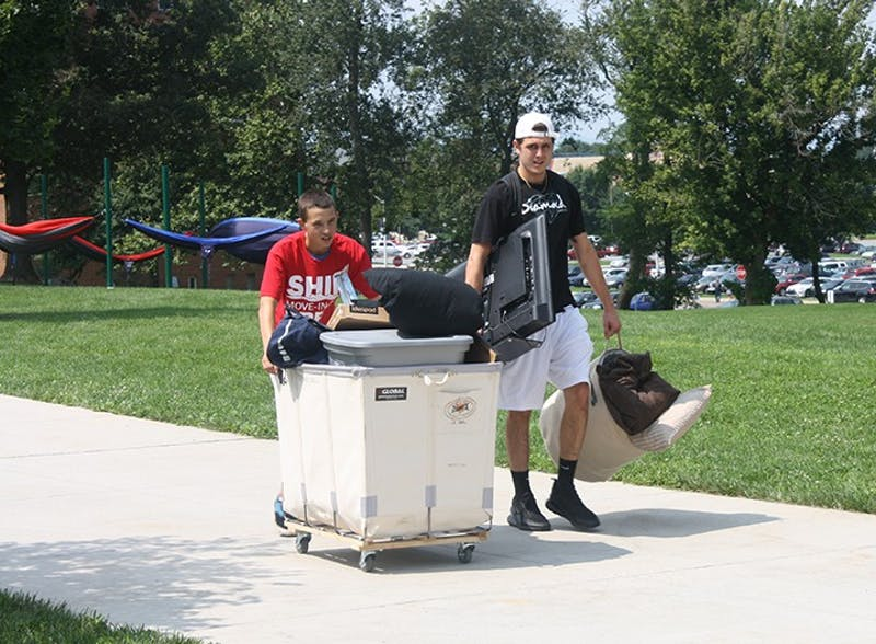 New and returning students use carts to move in items on move-in day. Many student groups such as sports teams, the marching band and the ROTC helped students and their families get settled in their dorms.