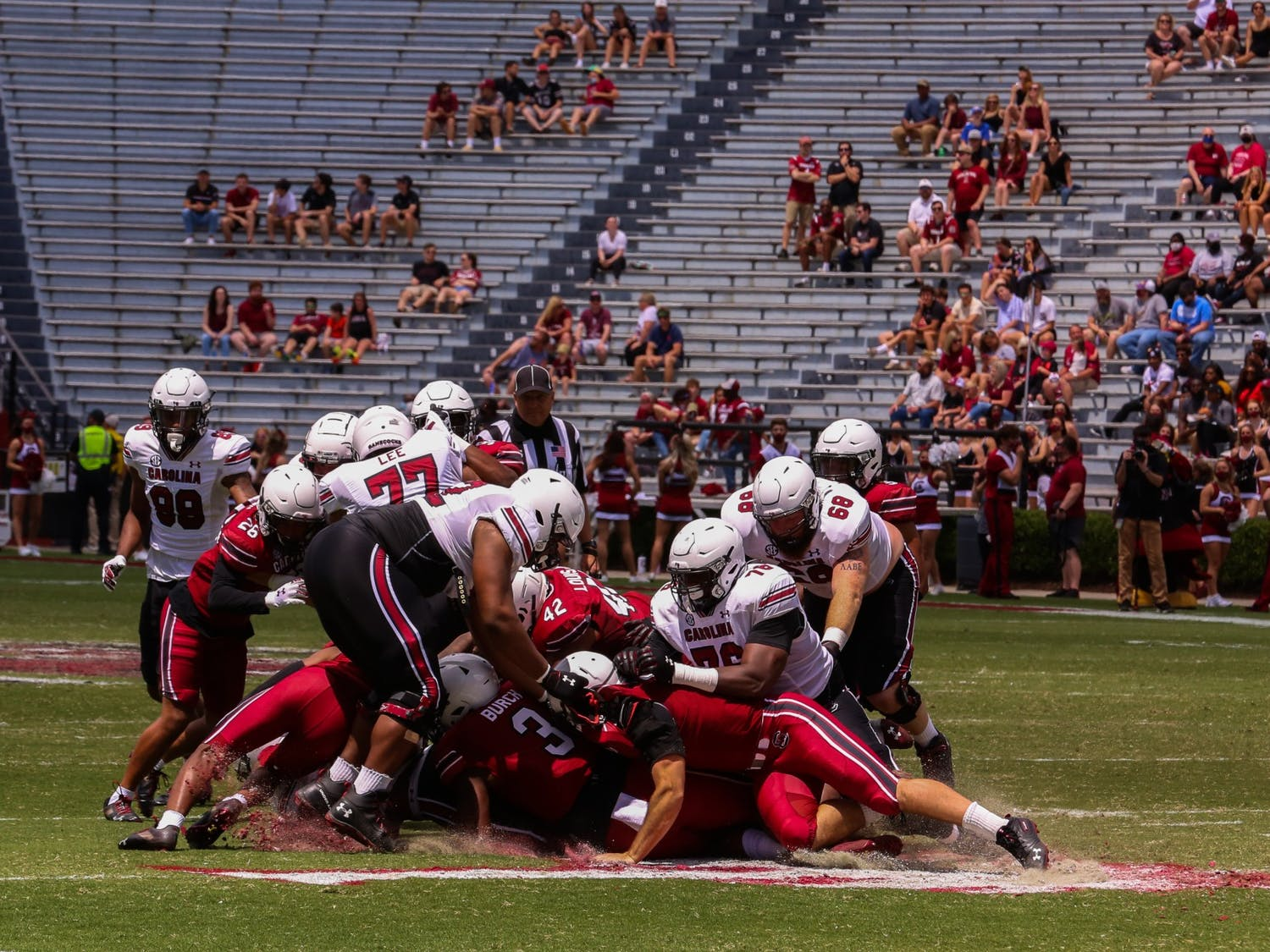 A dog pile happening between the two Carolina teams during the 2021 Spring game on Sunday April, 25.