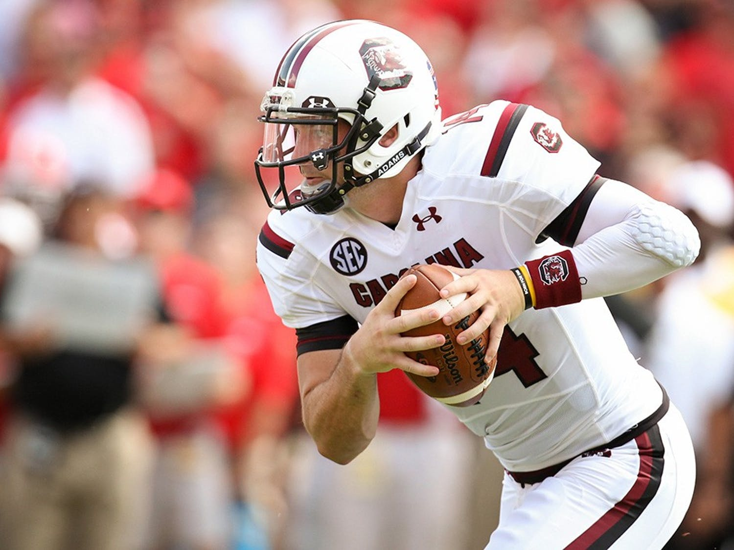 Connor Shaw, the starting quarterback from 2010 to 2013, carrying the ball down the field. Shaw is the winningest quarterback in school history and is one of the 10 new members being added to the South Carolina Athletics Hall of Fame in October.