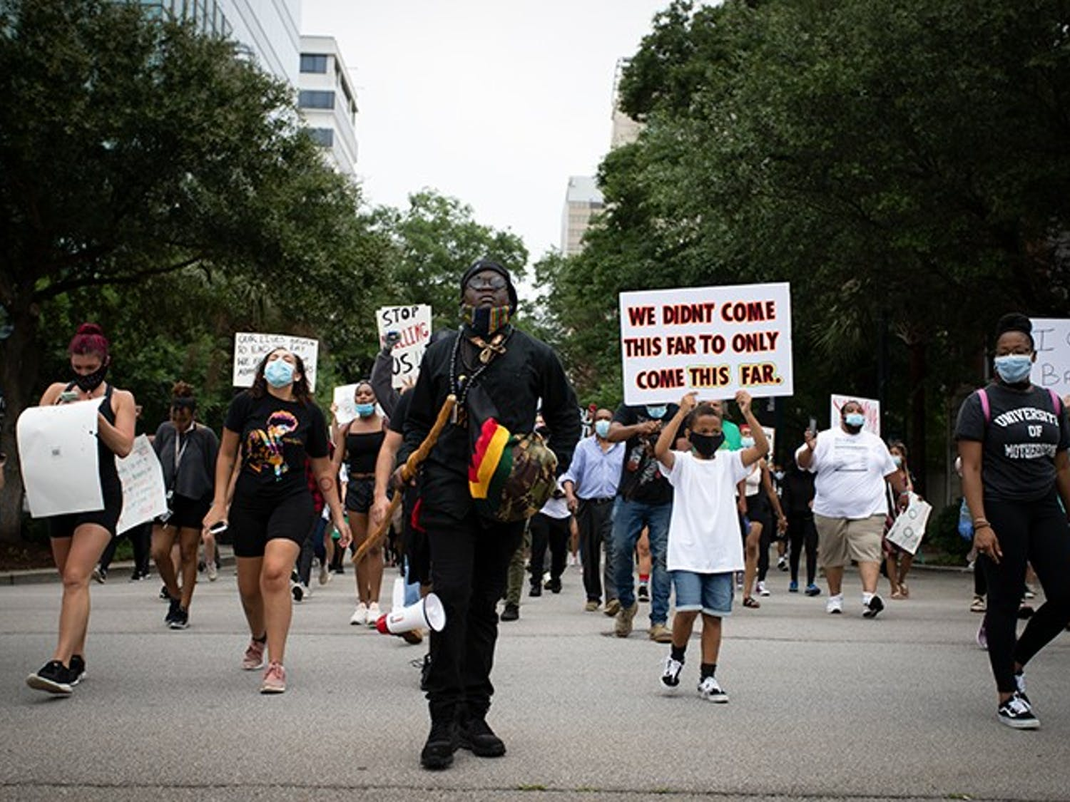 """People marching at the """"I Can't Breathe"""" protest move towards the Statehouse in Columbia on May 30."""