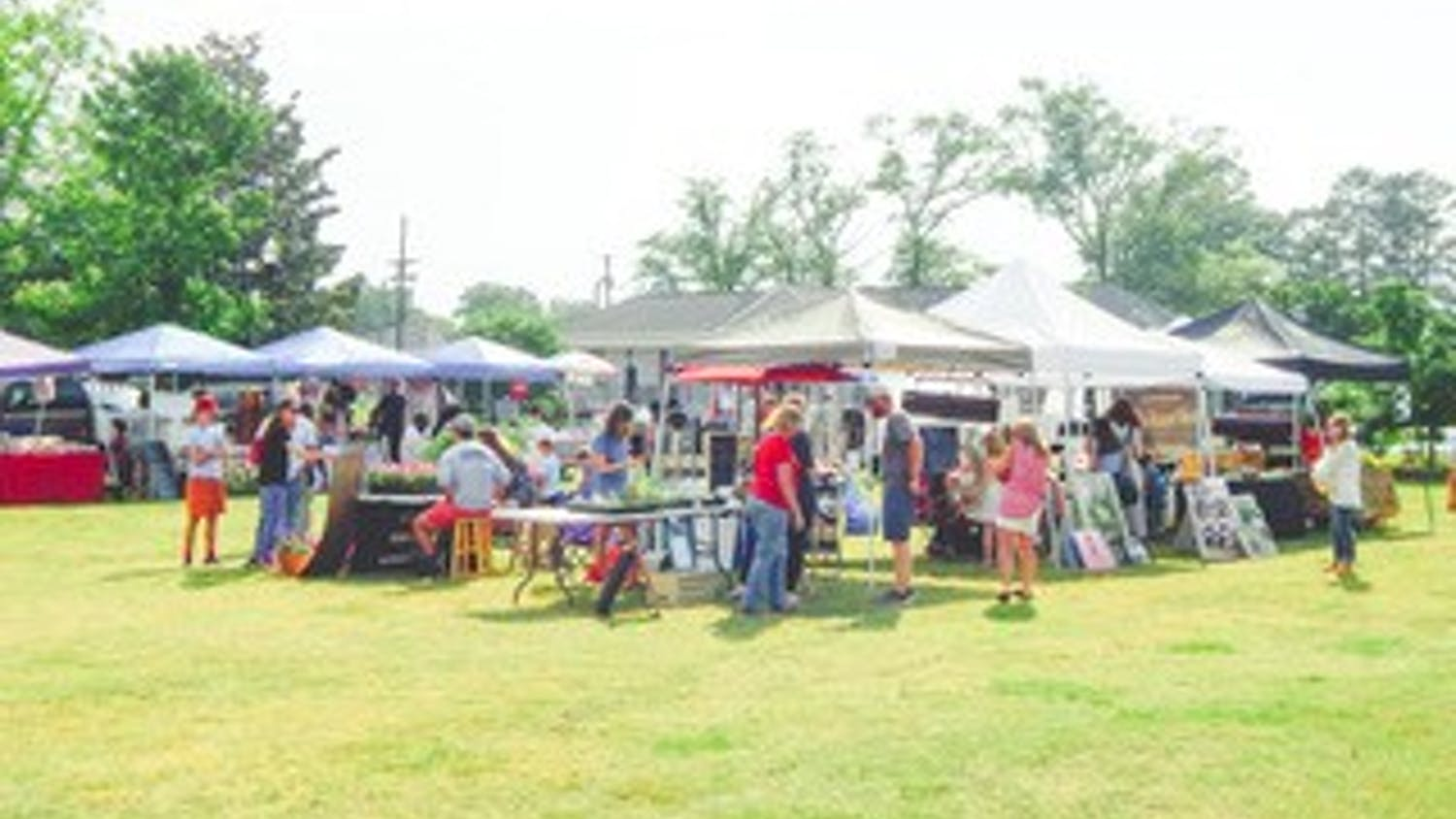 A view of the Blythewood Farmers Market, which has multiple booths set up.