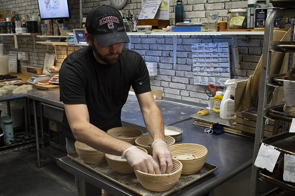 <p>&nbsp;Owner of Crust Bakehouse Zackery Gates works in the kitchen to prep inventory.&nbsp;</p>