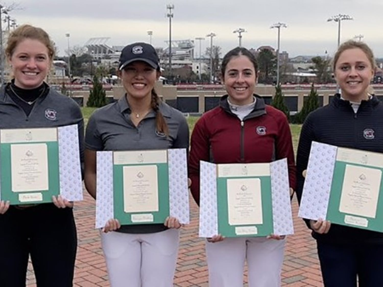 Four members of the South Carolina women's golf team pose with their invitations to the 2021 Augusta National Women's Amateur tournament.