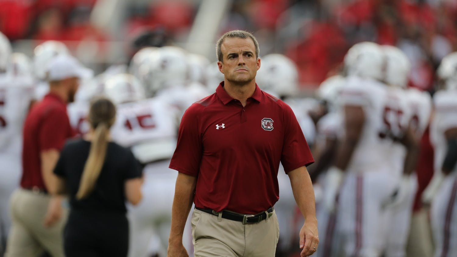 Head coach Shane Beamer walks on the sidelines during warmups before South Carolina's game against Georgia on Sept. 18, 2021.