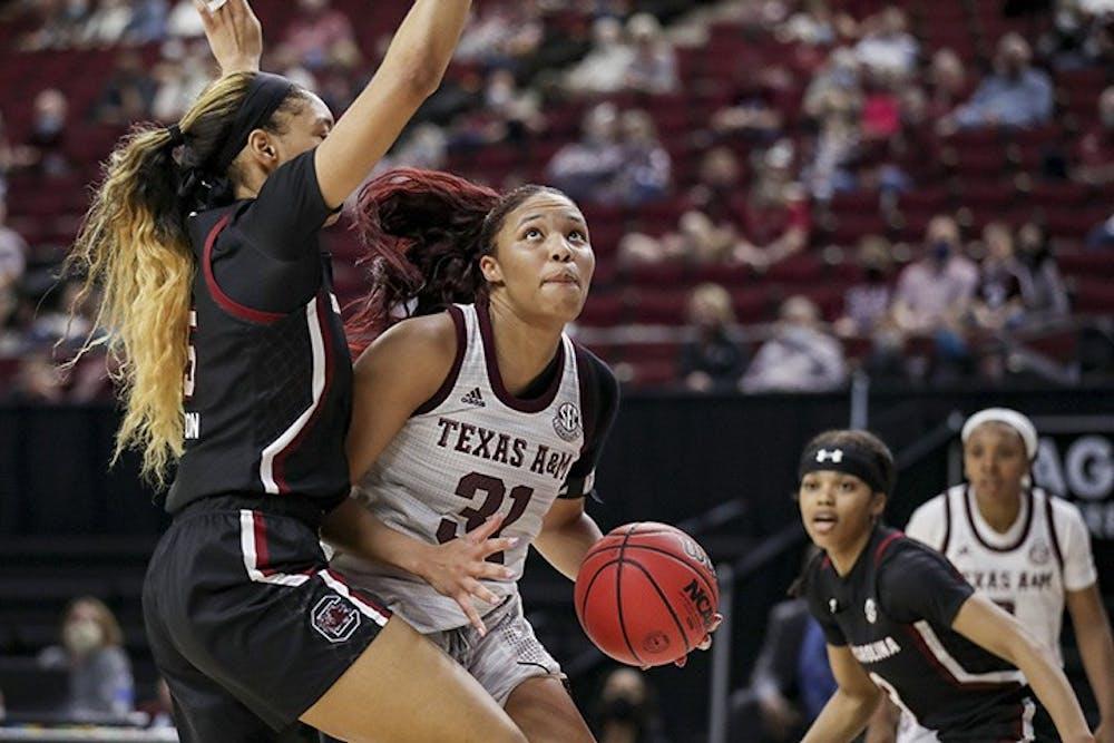 <p>Junior forward Victaria Saxton blocks Texas A&amp;M's senior forward N'dea Jones. South Carolina lost to Texas A&amp;M 65-57.</p>