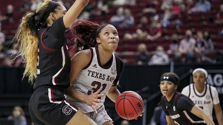 Junior forward Victaria Saxton blocks Texas A&M's senior forward N'dea Jones. South Carolina lost to Texas A&M 65-57.
