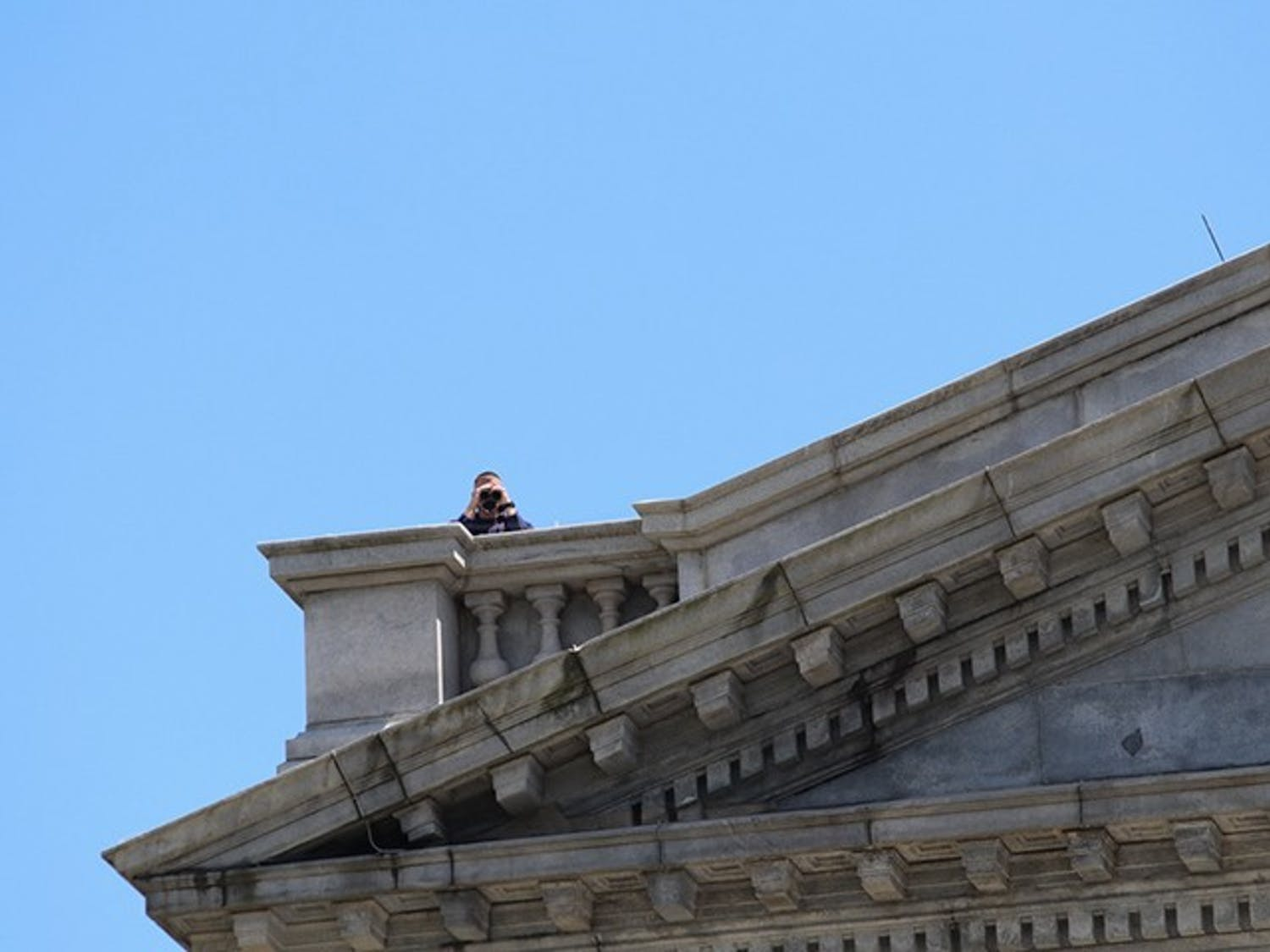 Snipers on the roof of the Statehouse monitor the protest from above.