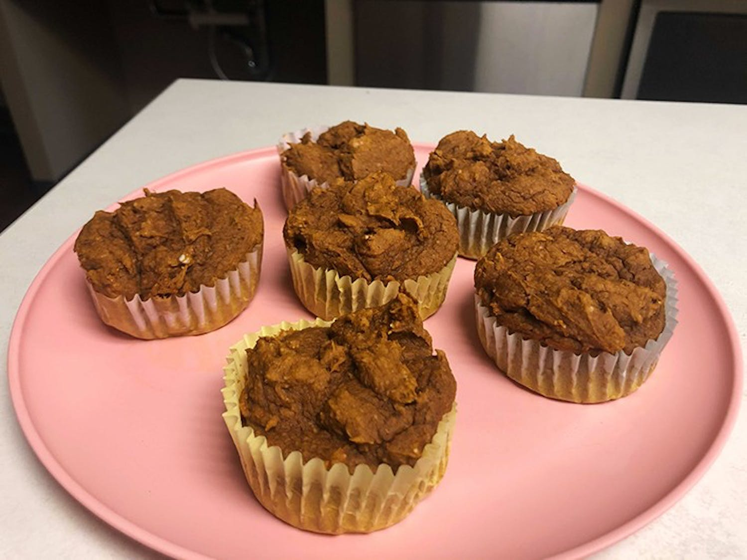 Pumpkin muffins sitting on a plate. The muffins are perfect for fall.